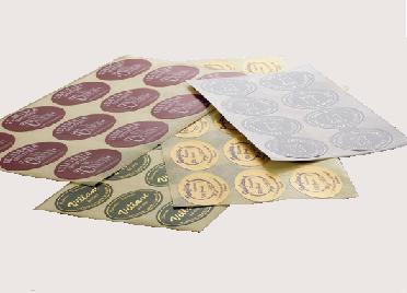 Adhesive labels and ribbons